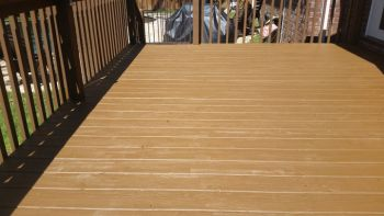 Railings of wood deck stained brown.
